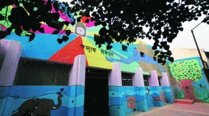 Children of juvenile home paint walls with themes of love and loss